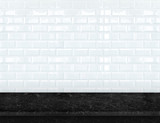 Empty black marble table top with glossy ceramic white tile wall