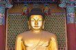 A big golden Buddha statue inside an ancient temple