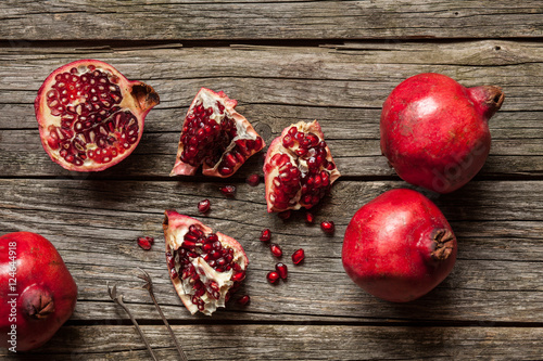 Poster Pomegranates on wooden table