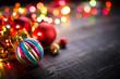 Christmas balls with Colorful Christmas lights on dark wooden ba