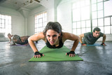 Confident female with drive leads endurance class fitness exercise weight training intensity