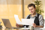 Businessman working comparing paper documents