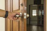 abstract scene of man open the wood door to room - 124748736