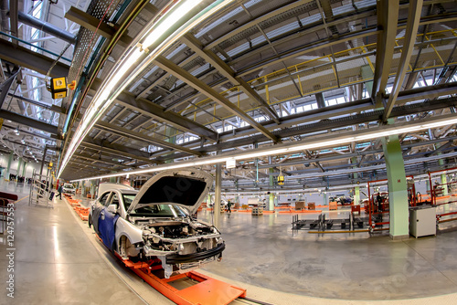 Foto op Canvas Kip The production line for the assembly of new vehicles