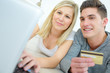 couple using credit card to make online purchases