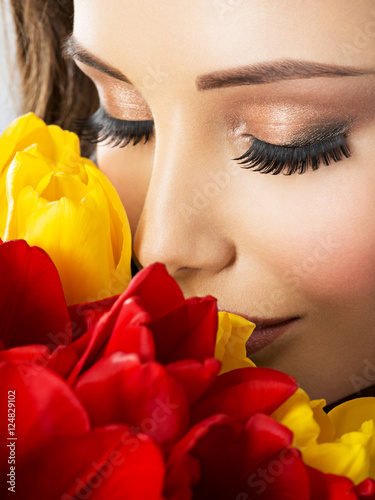 Closeup beauty  face of the young woman with flowers. Poster