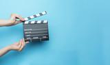 movie clapper on blue background, cinema concept - 124836131