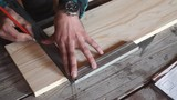 Male hands with ruler and pencil closeup. Professional carpenter at work.