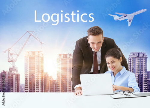 Business people working with laptop on cityscape background. Transport logistic concept.