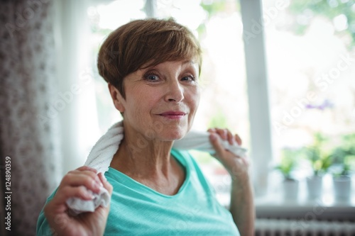 Senior woman holding towel around her neck