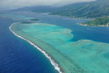The lagoon and barrier reef of Raiatea island, aerial view, south Pacific ocean, Society islands, French Polynesia  - 124907395