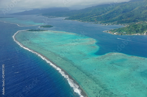 The lagoon and barrier reef of Raiatea island, aerial view, south Pacific ocean, Poster