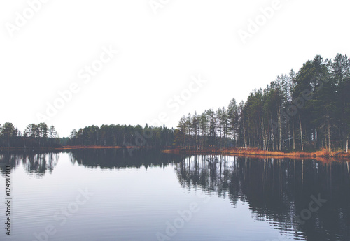 Reflection. Image of reflective water during autumn day. Image has a vintage effect. - 124917103