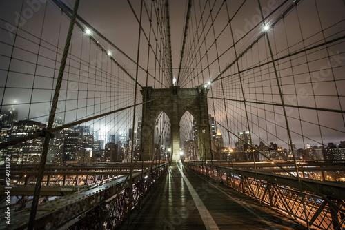 Brooklyn Bridge during a foggy night in New York