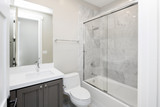Fototapety New Bathroom with marble and glass shower.