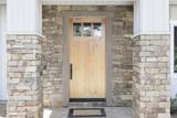 Wood front door of a home. View of a rustic front door in modern - 124944111