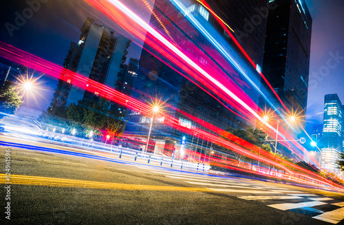 In de dag Tunnel blurred traffic light trails on road at night in China.