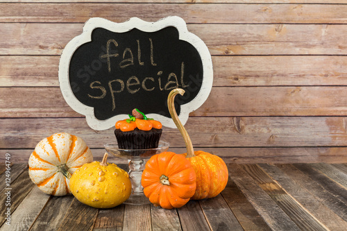 Poster Fall pumpkin muffin with chalkboard sign and decorative gourds