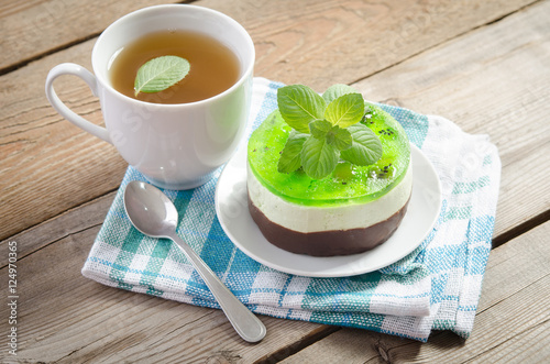 Fotobehang Thee herbal tea with cake on wooden background. horizontal position