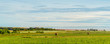 Panorama of hay bales on a farm along the ocean with the Confede