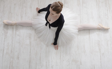 Classical Ballet dancer in split portrait, top view
