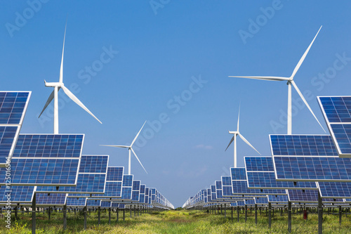 Leinwanddruck Bild            photovoltaics  solar panel and wind turbines generating electricity in solar power station alternative energy from nature