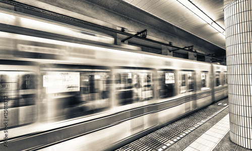 Foto op Canvas Scooter Tokyo subway. Fast moving train