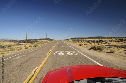 Fotobehang Route 66 view from red car on famous Route 66 in Californian desert, USA