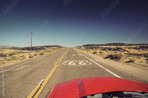 Foto op Plexiglas Route 66 view from red car on famous Route 66 in Californian desert, USA, Vintage filtered style
