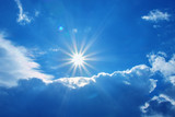 Bright shining sun with blue cloudy sky - 125066545