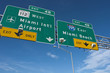 Interstate signs marking the way to Miami Beach and Miami International Airport
