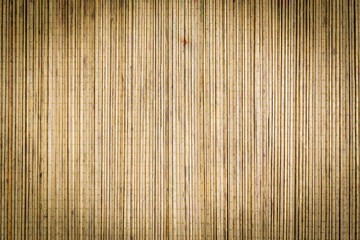 Bamboo mat background surface texture with vignette and antique filter applied to image ideal for Asian or Oriental subjects © David Pimborough
