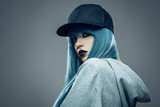 Young womanwith cyan color hair in hoodie and cap - 125120107