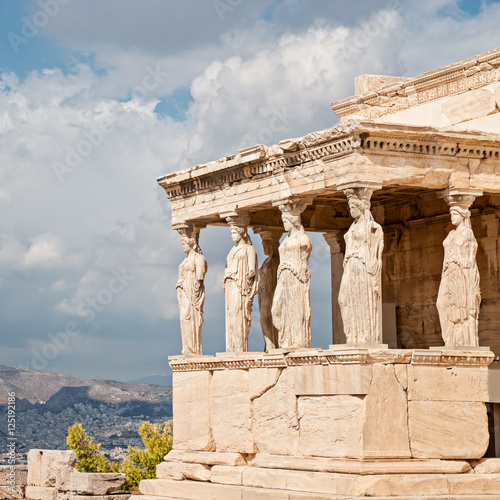 Staande foto Athene Acropolis, Erectheion, caryatids with panoramic view of the Athens, Greece