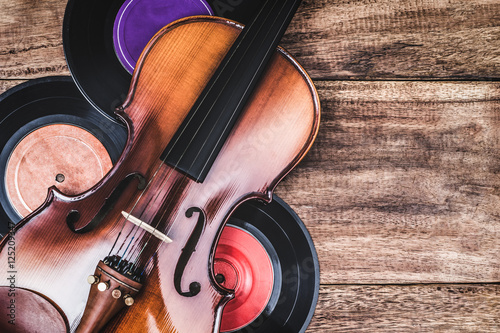 classical violin & records on old wooden table, vintage filter for music backgro Poster