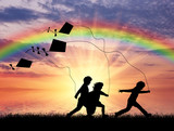 Children play with kite at sunset.
