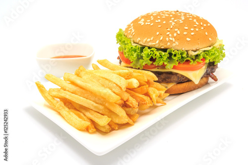 Poster tasty hamburger, French fries and chili sauce on white plate, Fast food with cop