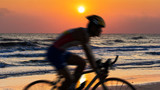 Cycling at beach on twilight - 125256536