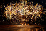 Fototapety beautiful Golden fireworks over the sea on night sky background