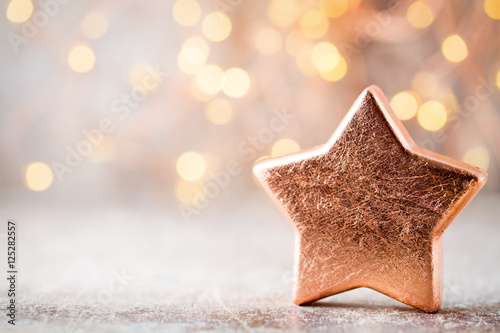 Poster Christmas bronze decoration. Holiday decorations bronze on bokeh