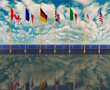 G7 countries flags on sky background