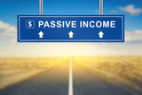 passive income words on blue road sign