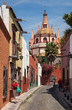 Beautiful Alley with Colorful Buildings Leading To Parroquia de San Miguel Arcangel church in Mexico