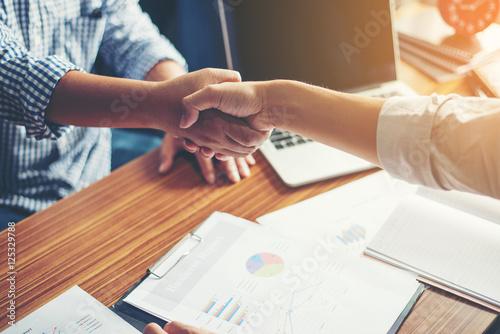 Fototapeta Business People Handshake Greeting Deal at work.