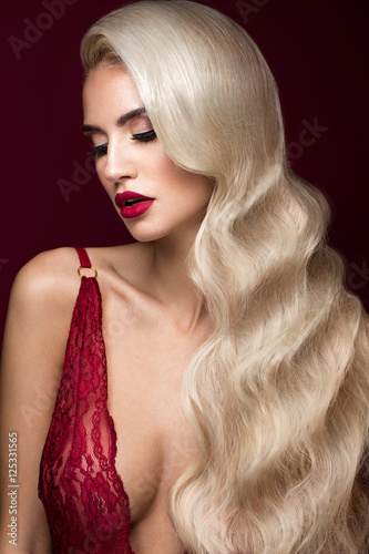Beautiful blonde in a Hollywood manner with curls, red lips, red lingerie Tableau sur Toile