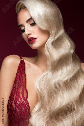 Juliste Beautiful blonde in a Hollywood manner with curls, red lips, red lingerie