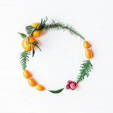 Christmas wreath with tangerines, cranberries, thuja branches, kumquats. Christmas conposition. Flat lay, top view
