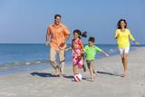 Family Playing Football Soccer on Beach