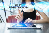 Woman is using tablet pc, pressing on virtual screen and selecting fast registration