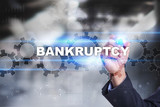 Businessman is drawing on virtual screen. bankruptcy concept. - 125362313